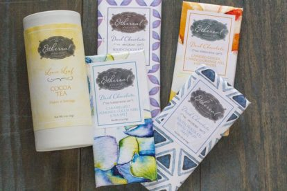 Ethereal Chocolate Bars and Cocoa Tea against blue wood backdrop