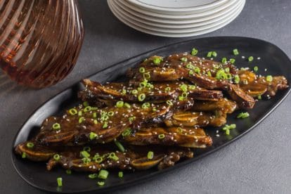 black oval platter of low FODMAP Korean BBQ Short Ribs with scallions