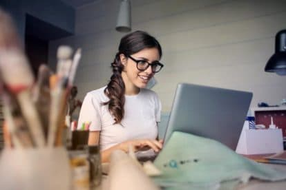 young woman studying on computer