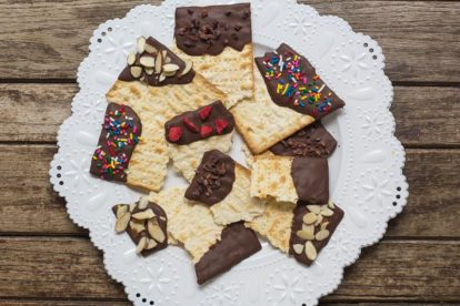 overhead low FODMAP Chocolate covered matzo on a white plate