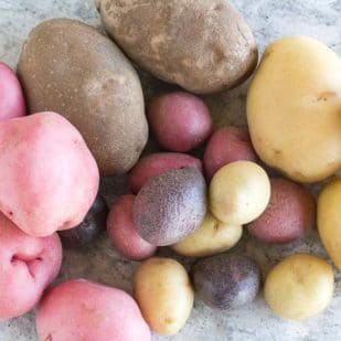 overhead view of an array of potatoes on gray quartz surface