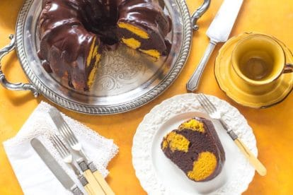 overhead image of low FODMAP Pumpkin Chocolate Marble Cake on yelllow background