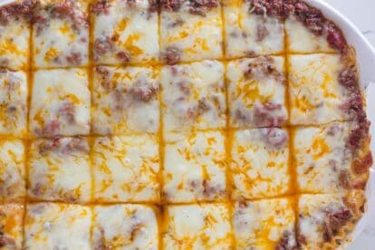 overhead image of low FODMAP lasagna in white dish against white background