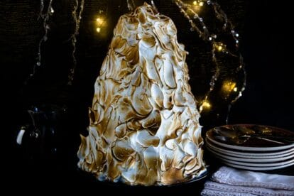 Low FODMAP Baked Alaska in a tree shape against holiday lights