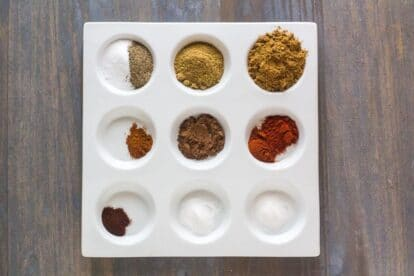 Low FODMAP Cumin Allspice Dry Rub ingredients in white dish with separate compartments