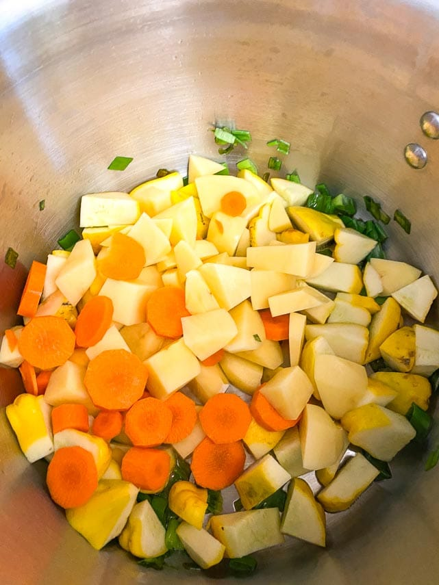 carrots, potatoes and patty pan squash cut into chunks, all together in a pot